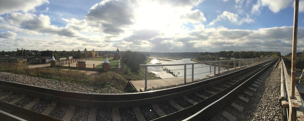 Panorama of the train tracks crossing the Luga River in Kingisepp.
