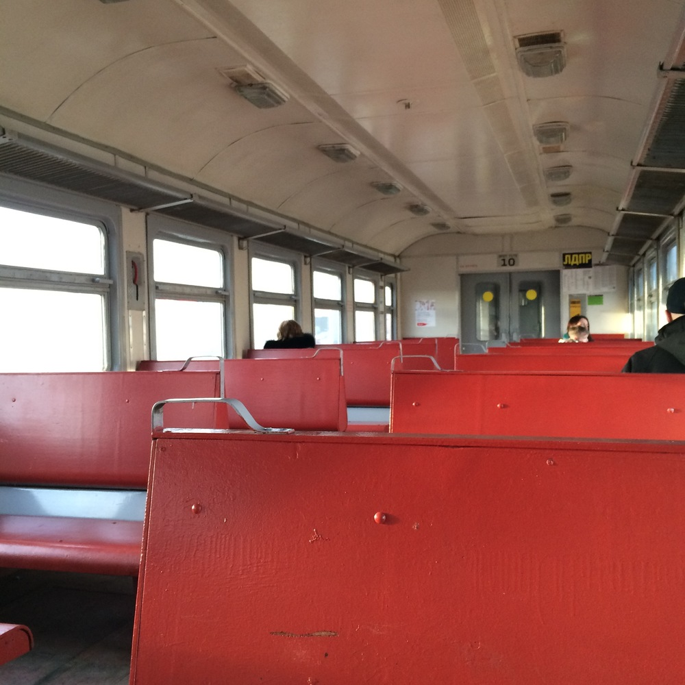 """The inside of a Russian elektrichka. Elektrichka is short for """"elektronniy poezd"""", which means """"electric train"""". They're the suburban/commuter trains of Russia... but also somewhat of a cultural icon."""