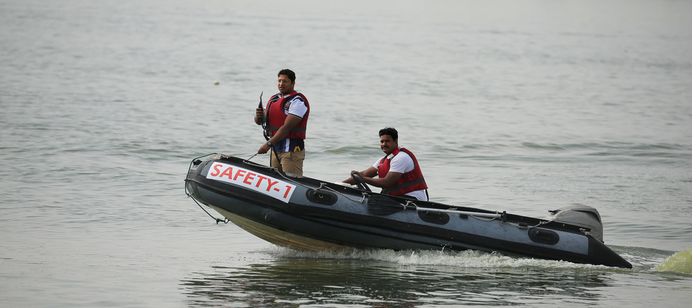 A Radio Equipped Safety Vessel with a trained Life Guard keeping a watchful eye