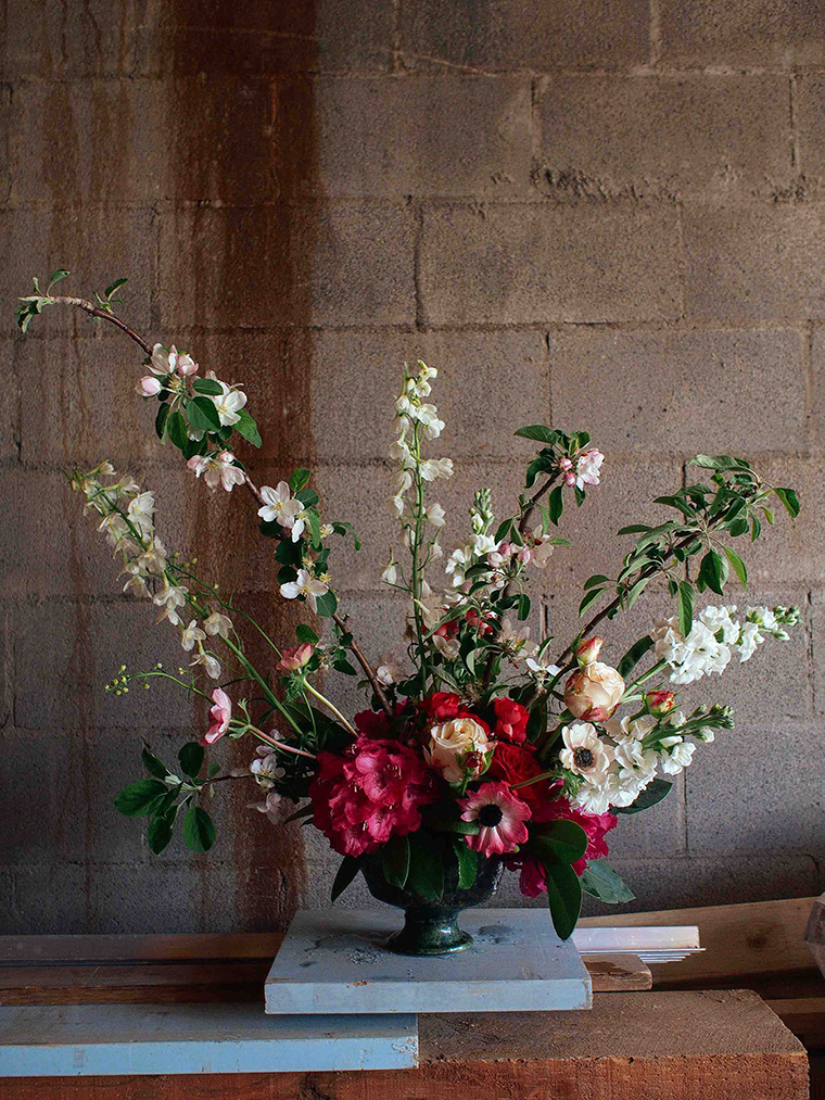 Eliza loves constructing grand arrangements, especially using large blossom branches foraged by the side of the road. In her own words they're 'a nod to that true flower of a woman, Constance Spry.' Photo: Eliza Rogers