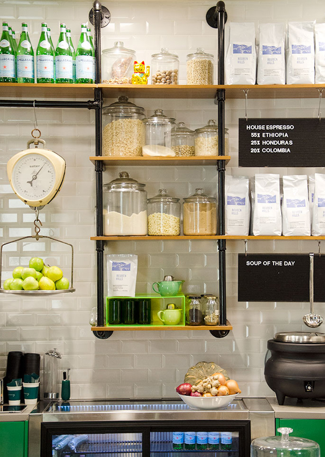Gramercy's ingredients neatly displayed in glass jars on custom pipework shelving. Photo:  Ezra La Vin