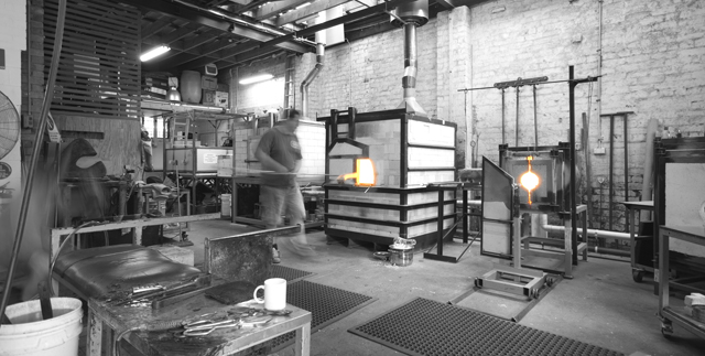 Glass blower Miles Johnson in action. Photo:  Ross Gardam