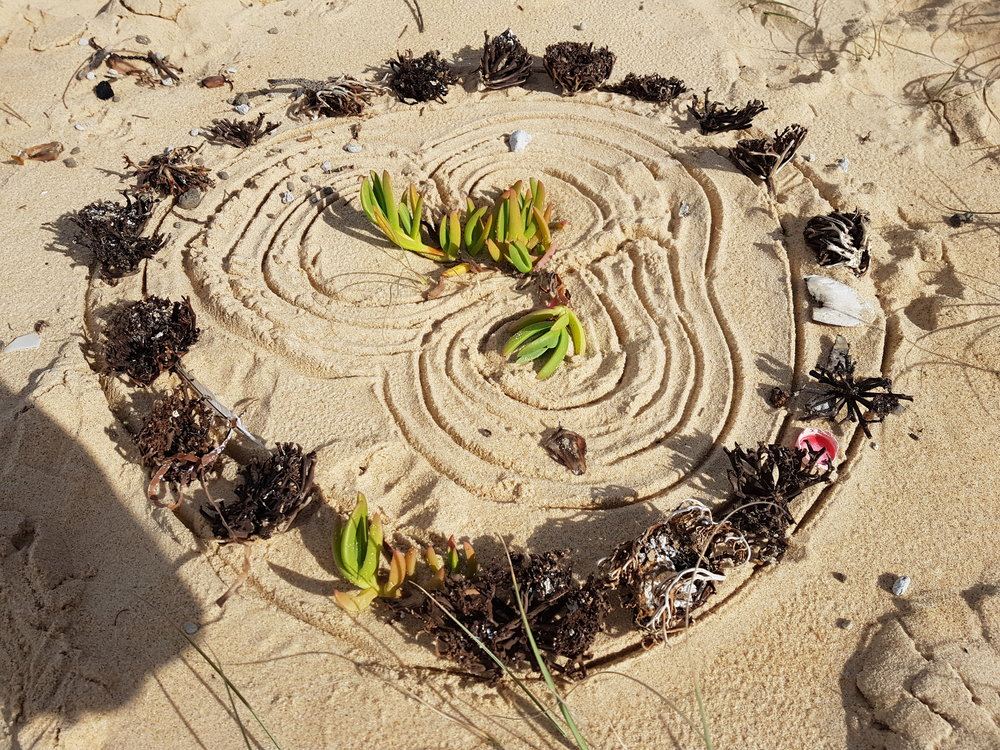 art making on the beach to be released to the wind and the tide - theme: mindfulness and letting go