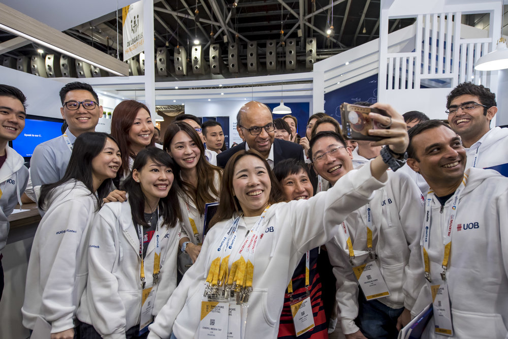 RIGHT PLACE AT RIGHT TIME: Our clients taking a wefie with Deputy Prime Minister Tharman Shanmugaratnam at the Singapore Fintech Festival. Photo by Captured.