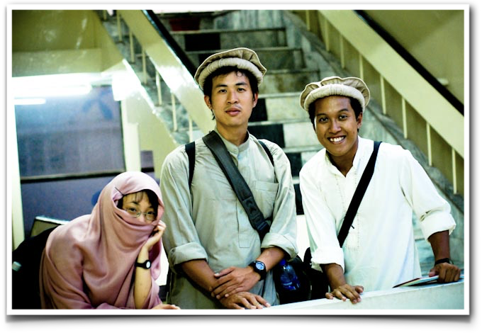 Edwin, pictured here wearing a traditional Pakistani shawal qameez, with his Singaporean friends Zakaria and Yenling, during his first trip to Pakistan in 2009.