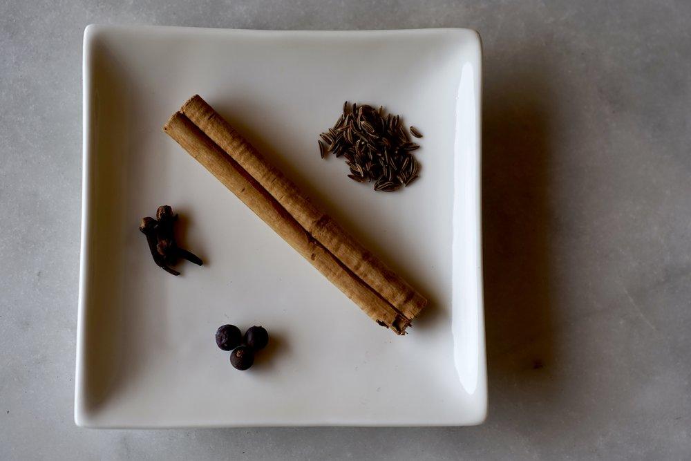 cloves, cinnamon, juniper berries, caraway seeds