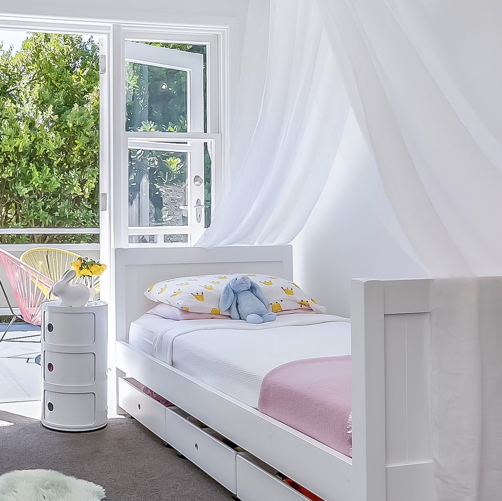 When preparing our home we removed the top bunk and added the canopy so this bedroom didn't look cramped and had some wow factor.