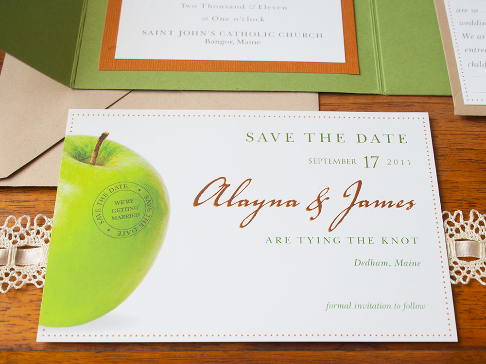 Mossy green, apple red and autumn orange rustic fall invitation design. Includes a moss green envelopment, main invite, R.S.V.P.  mad libs card, save the date postcard, program and custom map of local area with nearby must-see places recommended by the couple and directions to the ceremony to the reception. All items enclosed in a kraft paper envelope.