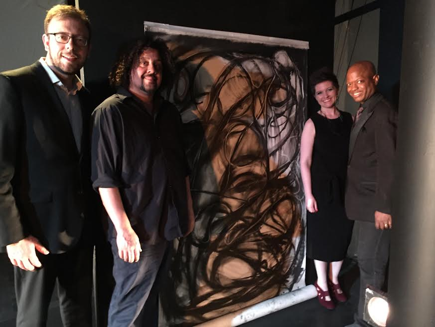 Brian Holman, Byron Singleton and artist Rufino Jimenez with the piece he created during Les Illuminations.