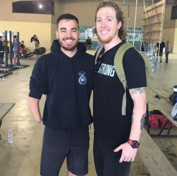 Jake (pictured on right) with athlete, Daniel Crane at a local event.