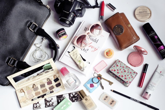 A complete list of everything that every woman should have in her purse.