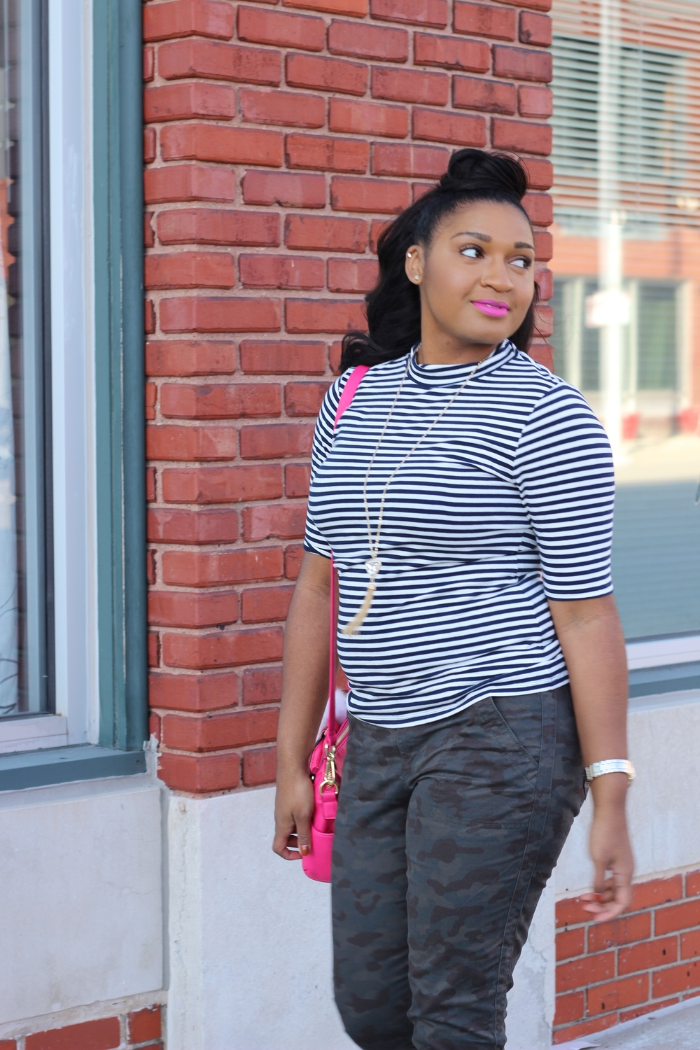 Kansas City fashion blogger wearing camo pants with a stripe turtleneck top.