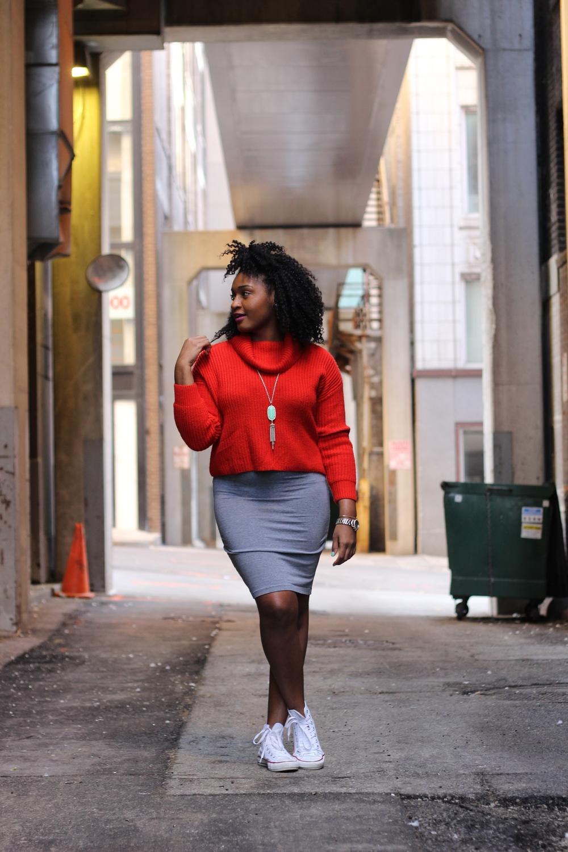 orange turtleneck on a black blogger