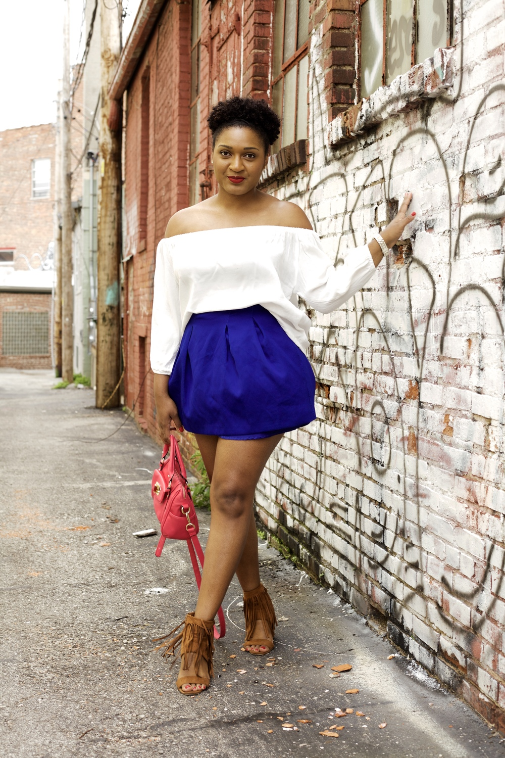 Black fashion blogger Jasmine Cooper of jasminediane.com wearing off the shoulder white blouse with a blue skirt and hot pink bag from target in Kansas City.