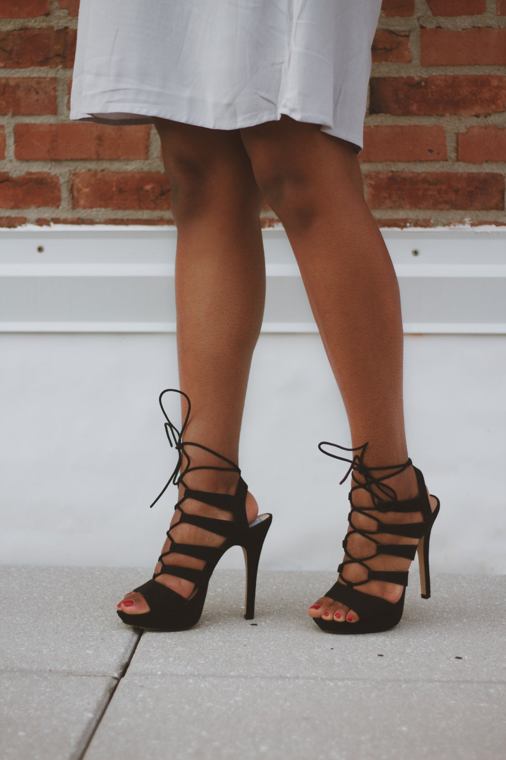 black strappy heeels by steven maddedn