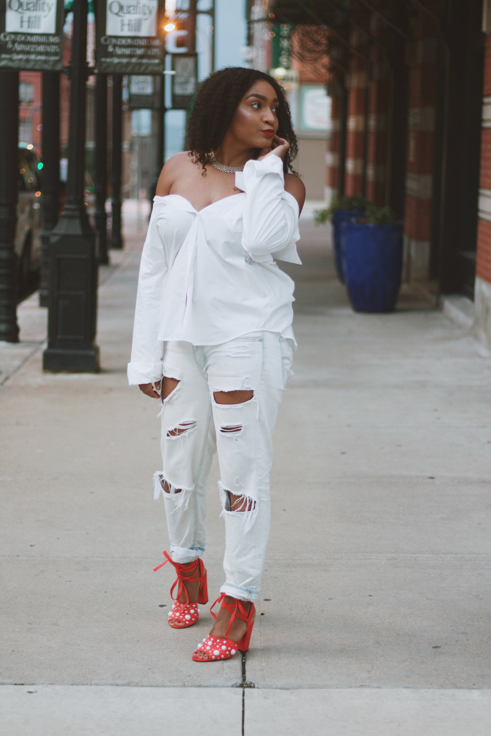 White shirt and boyfriend jeans with red block heels.