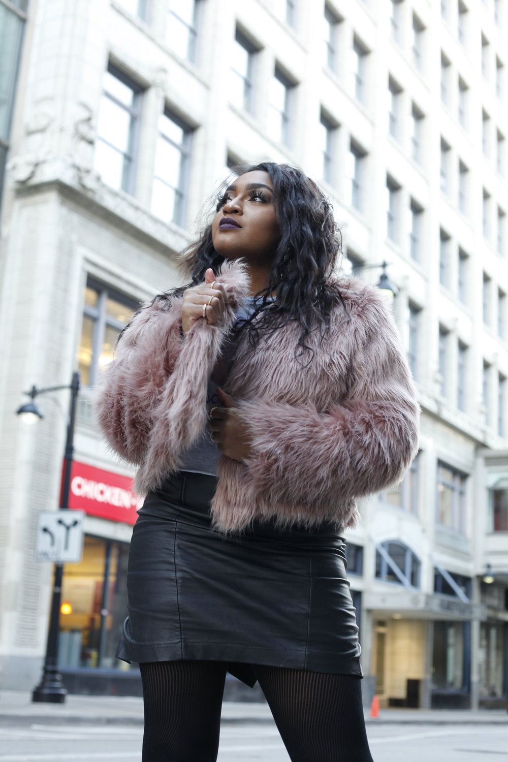 black blogger wearing faxus fur.JPG