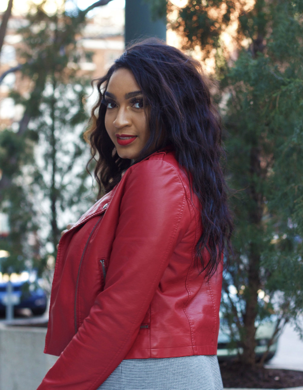Jasmine Diane in red moto jacket from Forever21 in downtown kansas city.jpg