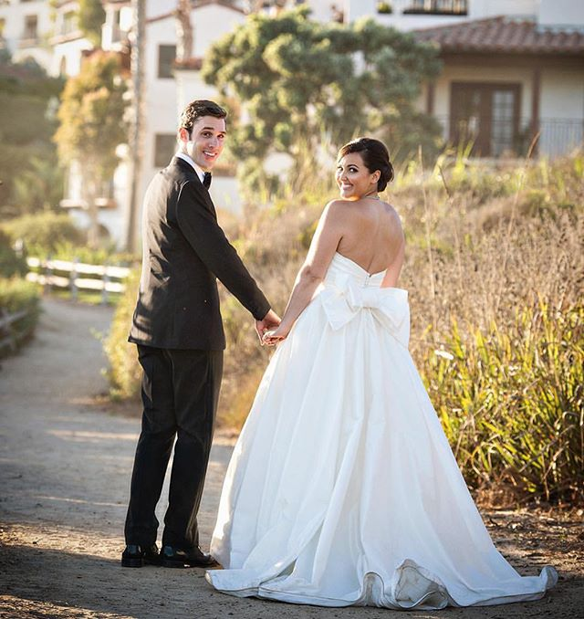 This chic wedding...and the epic wedding gown bow...was featured in @hollywoodreporter! Photo: @lauriebaileyphoto  Planner: @amberweir  Venue: @bacararesortsb  Gown: @romonakeveza