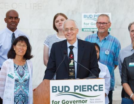 Photo: Bud addressing a crowd   on the Oregon Capitol building steps.