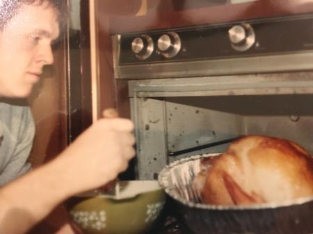 Photo: Bud basting the turkey for Thanksgiving dinner in 1981.
