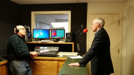 Photo: Bud speaking at KFLS Radio in Klamath Falls.