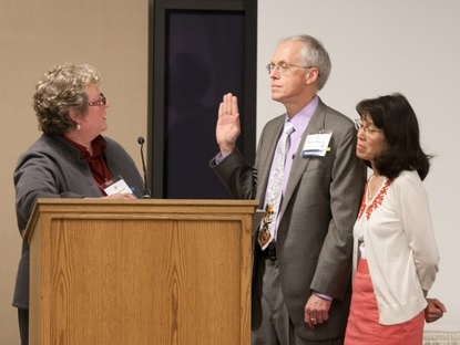 Photo: Bud being sworn in as the Oregon Medical Association President by Dr. Carla McKelvey.