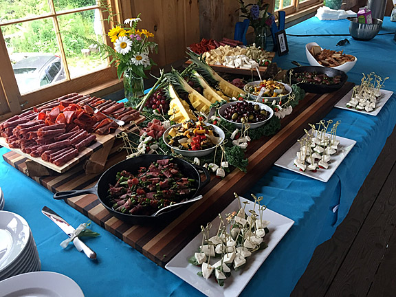Antipasto   An abundant spread of cured meats, roasted veggies, cheese, olives. Caprese skewers shown in the front can be added, as well as prosciutto wrapped  asparagus shown in the pan.