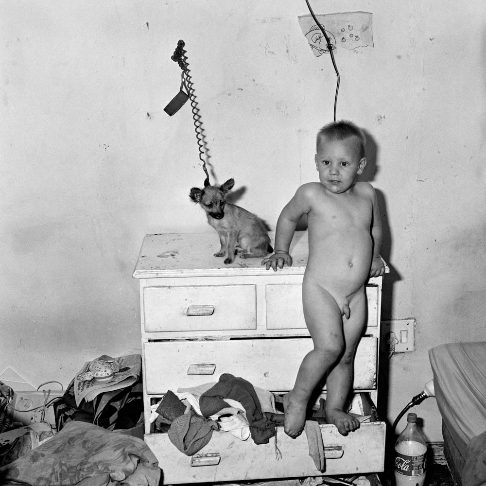 Roger Ballen - Baby on Chest of Drawers, 2000