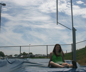 Chlotille Scheckel poses next to the pole vaulting station.
