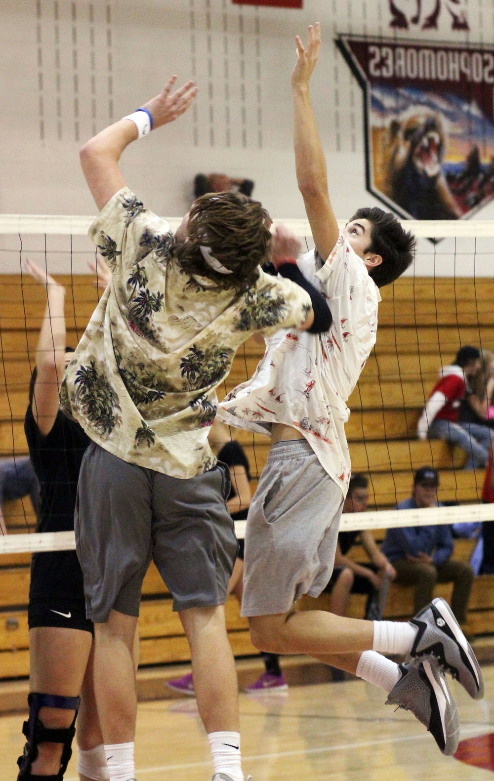 Seniors Connor McIntyre and Caleb Hernandez go up for a ball during the Rough and Tough Volleyball Tournament.