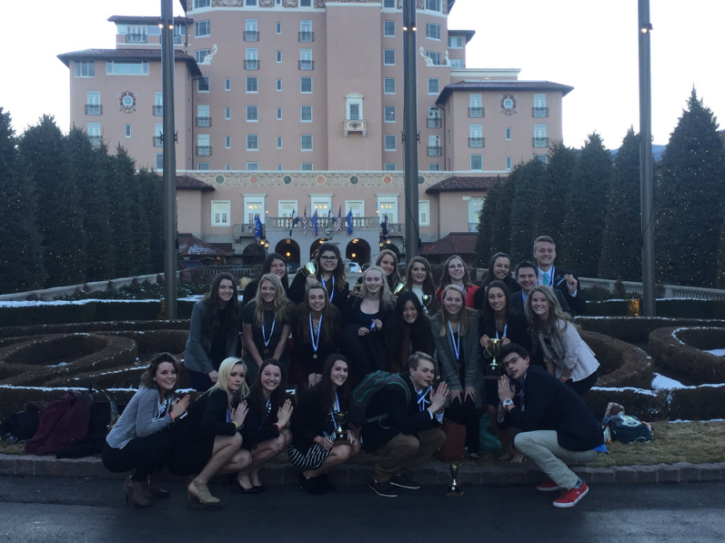 DECA officers pose with awards in front of the Broadmoor Hotel. Photo provided by Sara Mossman