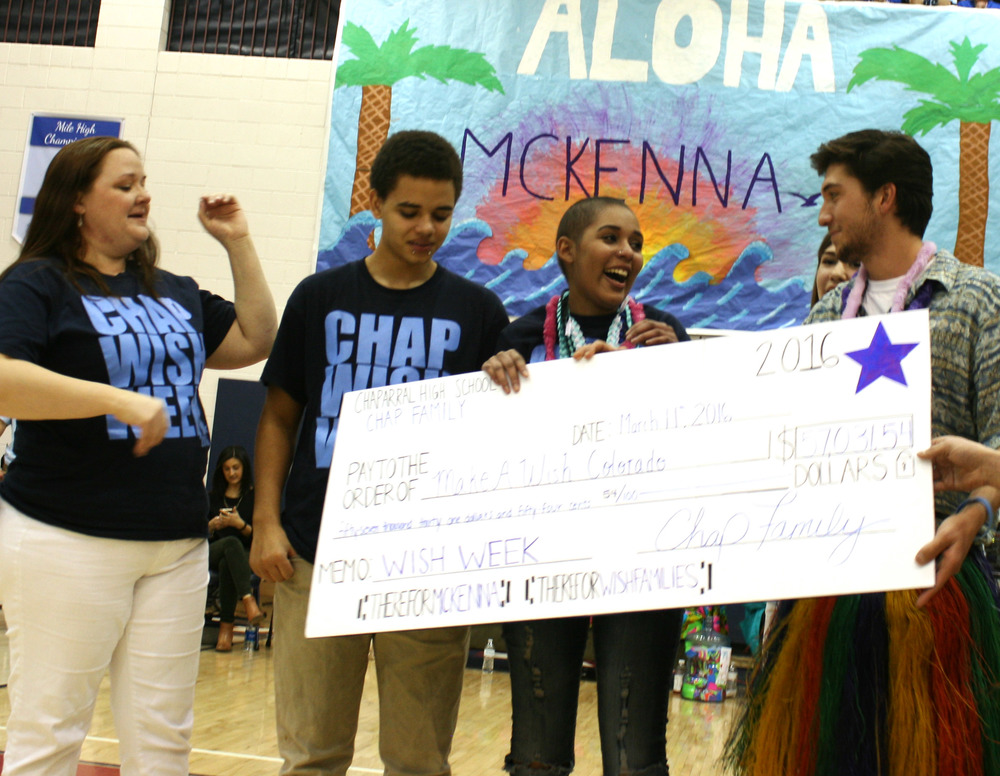 16 year old McKenna flashes her contagious smile as she holds the check that will help send her to Hawaii. Photo by Aubree Miller