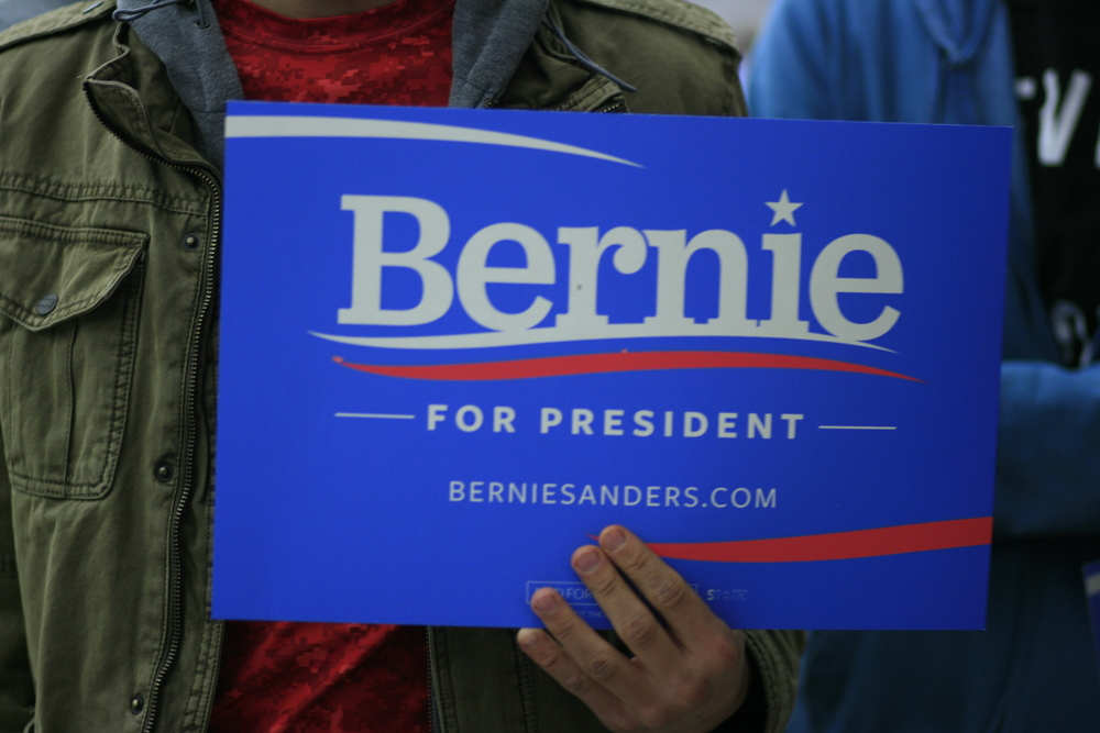 A citizen bares a sign in support of Democratic candidate, Bernie Sanders, at the Colorado caucus in March.