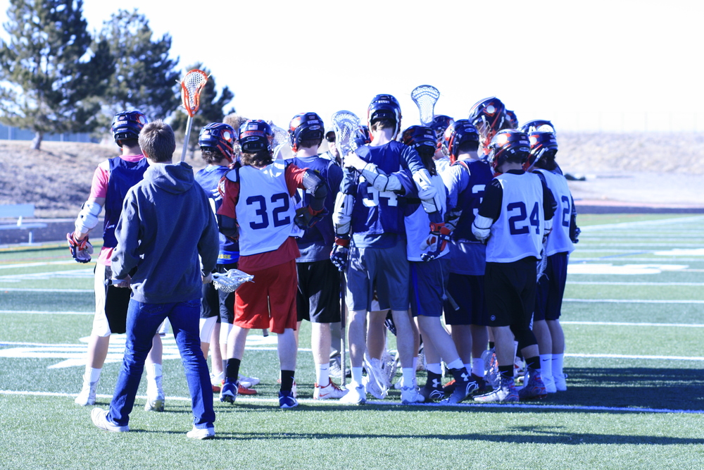 Boys lacrosse comes together after their final league game. Photo by Amanda Lehman.