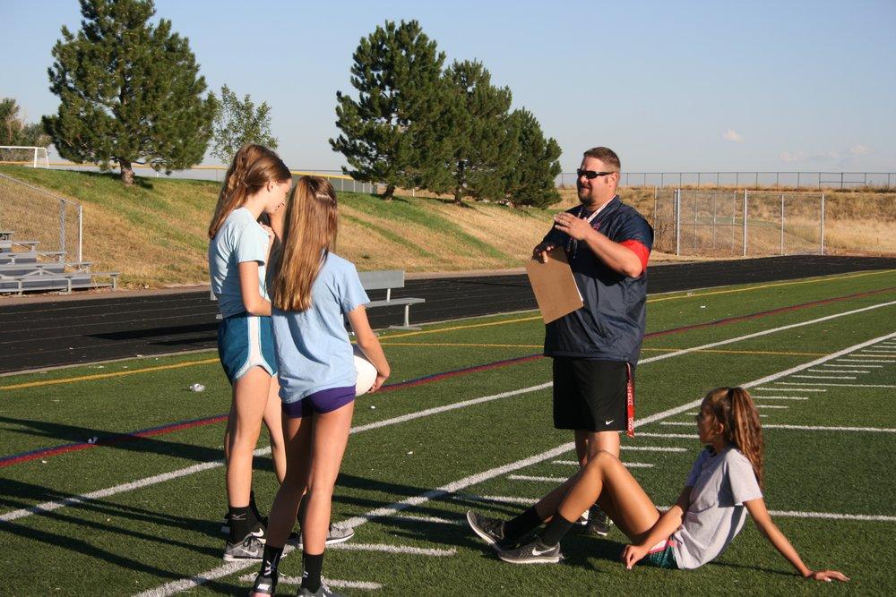 Coach Larkin Giving a Lesson