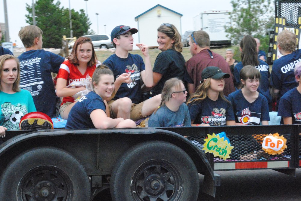 Unified Soccer throws candy during the homecoming parade. Photo by Aubrey Bowlus