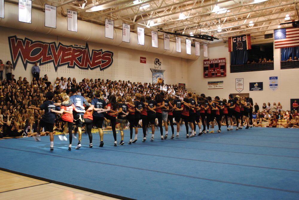 Guy Poms combine with Girl Poms to create a routine that gets the whole crowd energized. Photo by Lauren Haviland