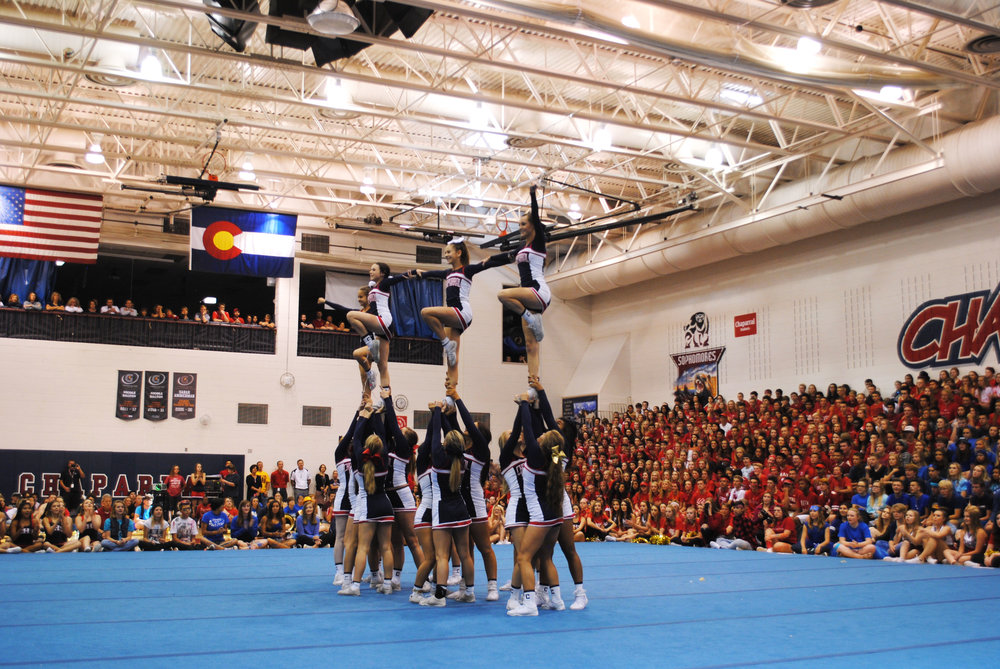 Cheer raises up their teammates in their homecoming performance. Photo by Lauren Haviland