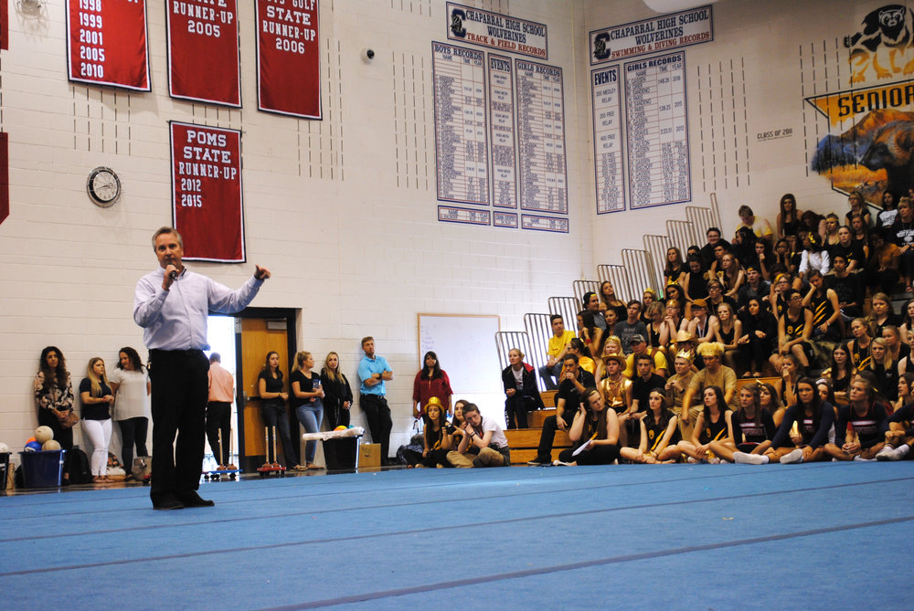 "Greg Gotchey addresses the student body, finishing with the famous phrase, ""Take care of one another."" Photo by Lauren Haviland"