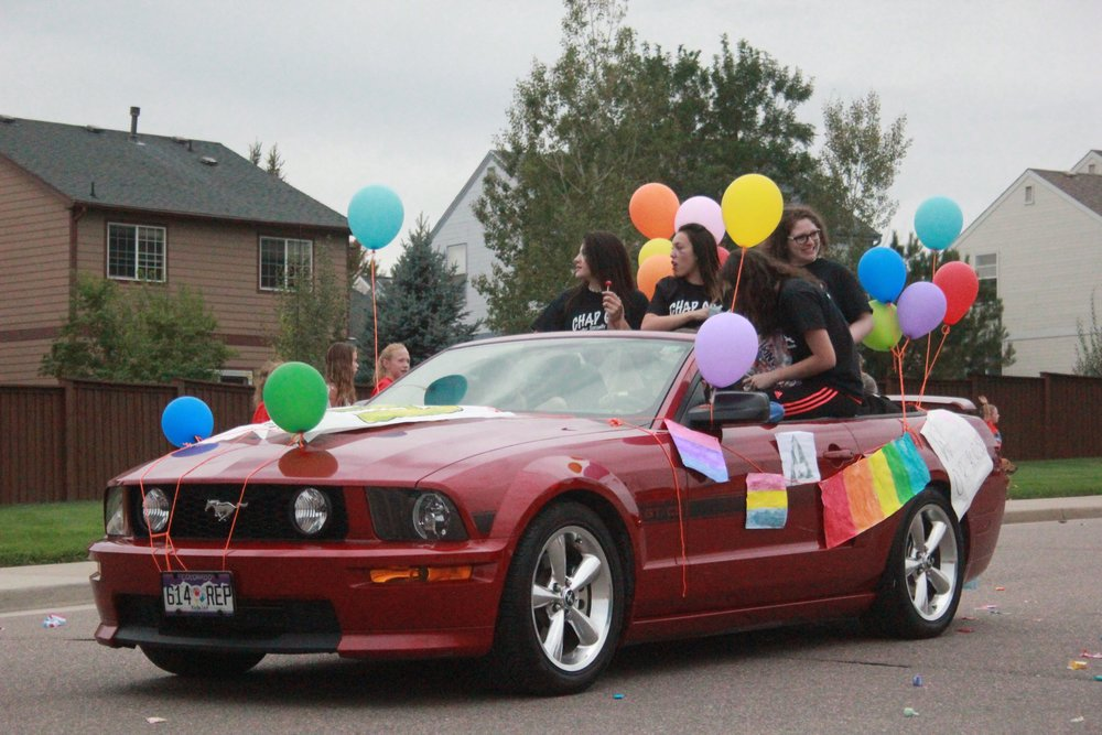 The student- run club, GSA, in their Mustang during the homecoming parade. Photo by Katie Baker