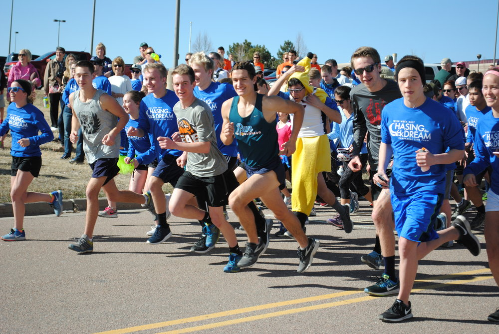 Contestants in the Chasing the Dream 5k begin running after the opening shot. Photo by Olivia Goodman and Shayanna Spader