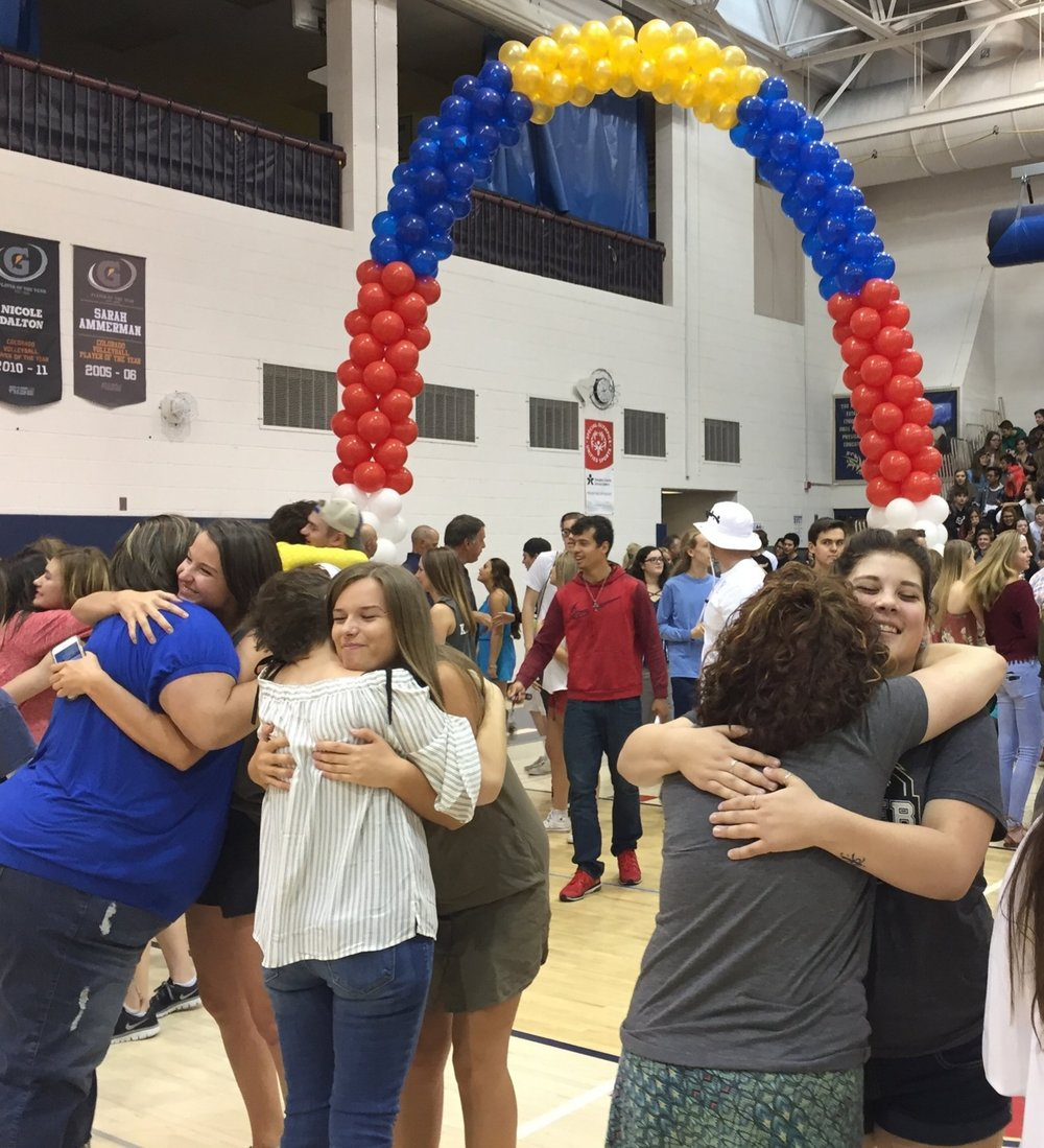 Students and teachers embrace saying their final goodbyes at the senior assembly. Photo by Matt Fast