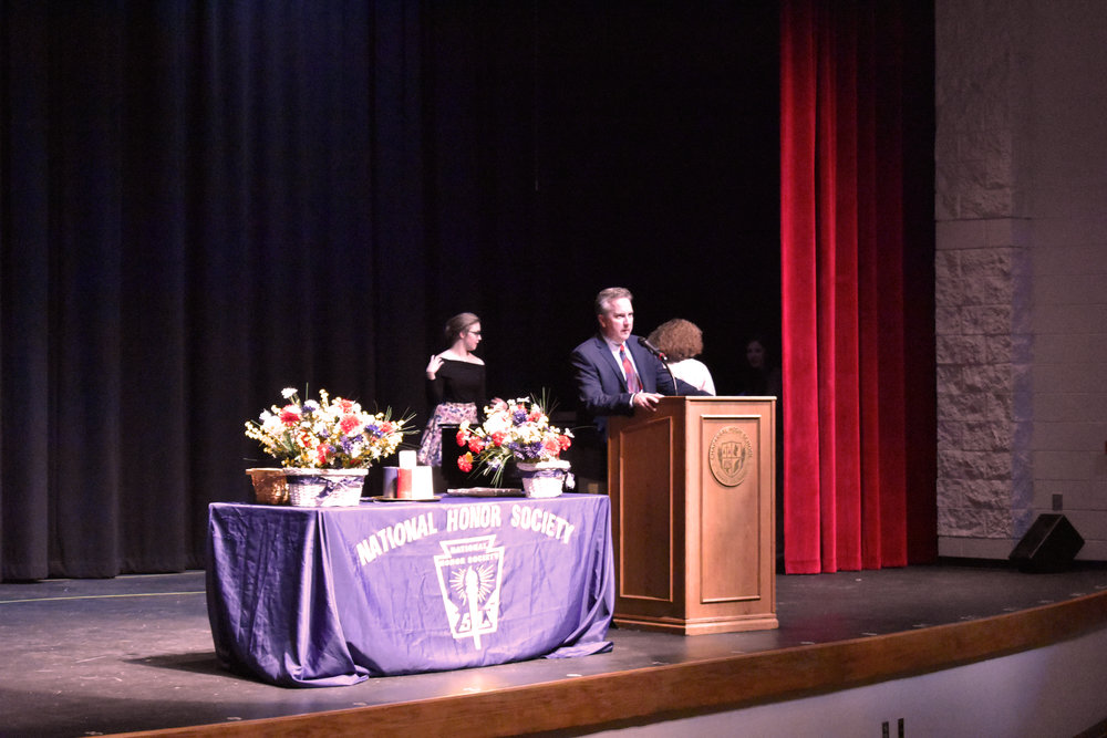 Principal Greg Gotchey addressing the audience and new NHS inductees. Photo by Reggie Quiming.