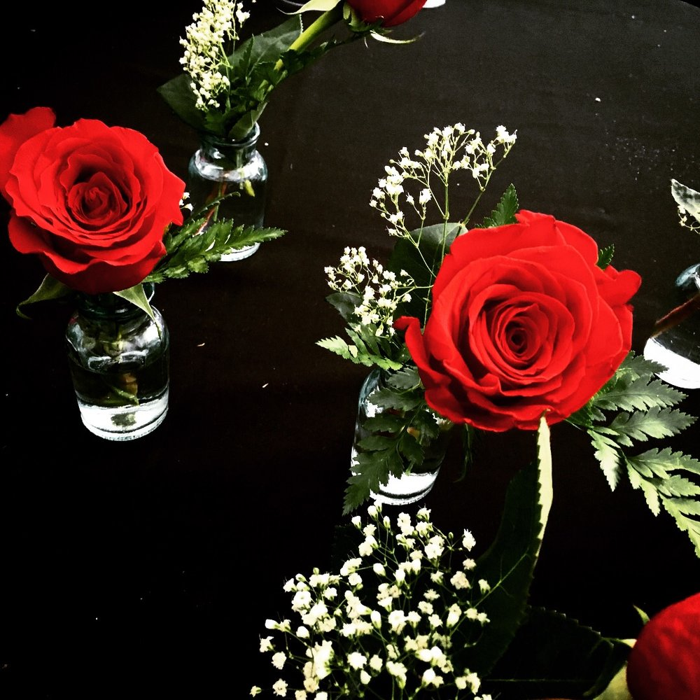 I selected flowers and vases as well as made each center piece.
