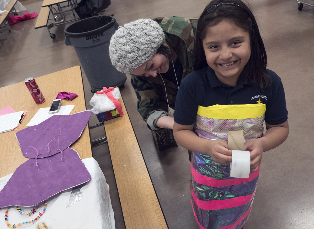 12/2107-Minneapolis, St. Paul, MN - Art Buddies. Kids make costumes with materials from bins of crafts.