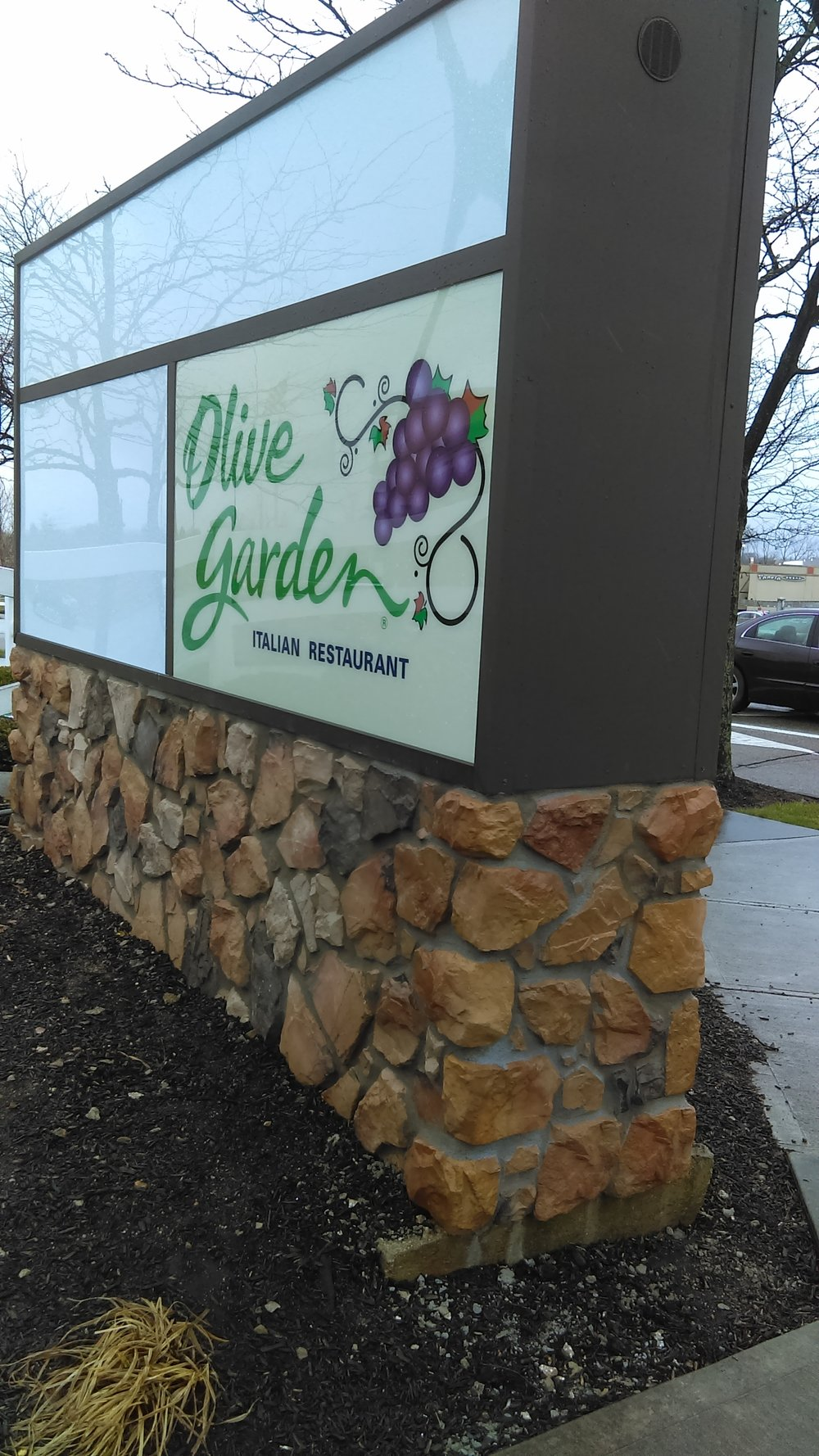 Remodeled the sign and stone pedestal for this Olive Garden after a car accident.