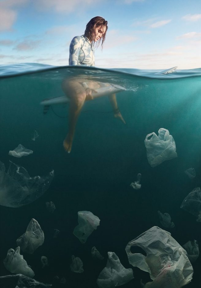 Plastic Bags float like jellyfish beneath a surfer.