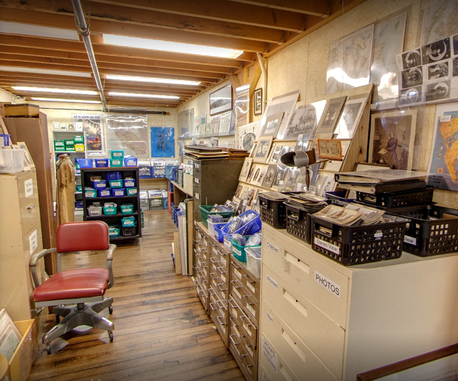 For a lover of old photographs, it is easy to spend half a day in a room like this, at an antique mall in Monterey, California. The stereoscope or 'viewer' hangs from the ceiling above the filing cabinets