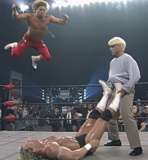 Brian flies while Luger is held by Cliff Huxtable.
